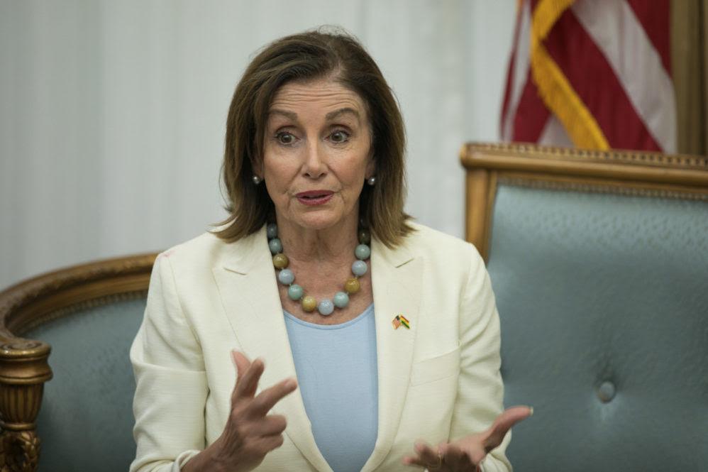 Nancy Pelosi sits without a mask