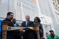 Kevin Turner, third from left, cutting a ribbon during the opening of the first Microsoft store in New York in October 2015.