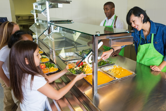 Woman serving food to children