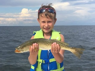 Cole holds a spotted seatrout