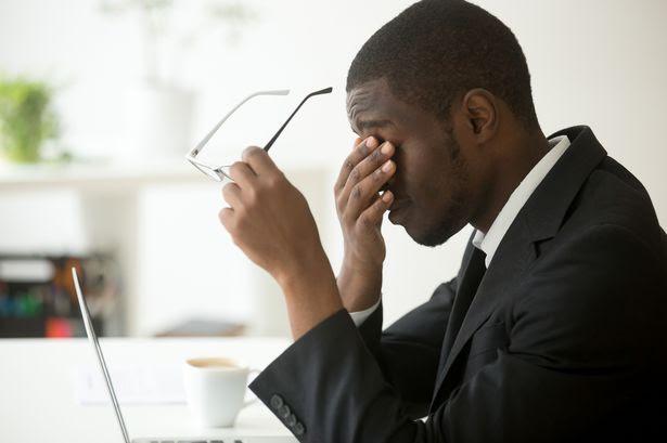 2_Tired-of-computer-african-businessman-taking-off-glasses-feeling-eyestrain1.jpg
