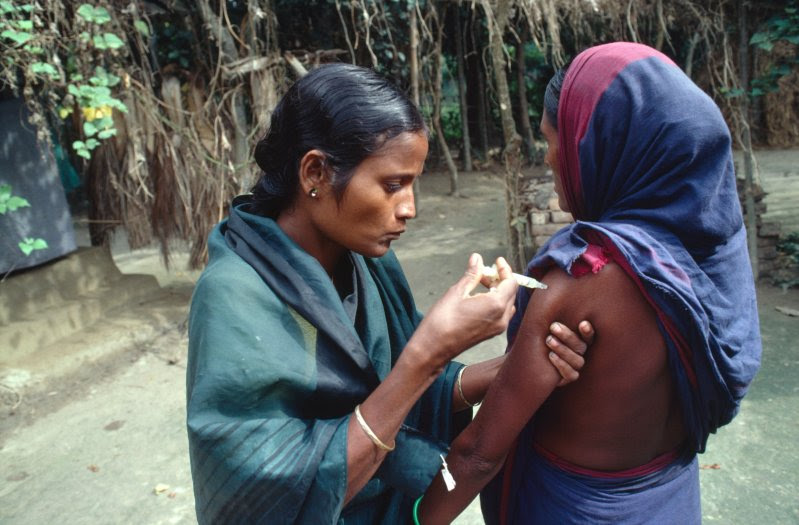 Hashina Akhtar giving A three-monthly injection of the contraceptive Depro-Provera in Mobarakdi Village, Matlab District.