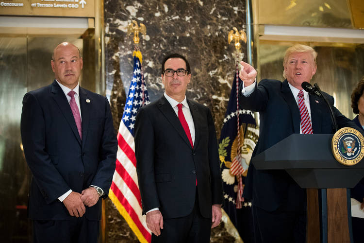 Director of the National Economic Council Gary Cohn and Treasury Secretary Steve Mnuchin.. (Photo by Drew Angerer/Getty Images)