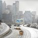 Snowplows cleared a deserted interstate in Atlanta.