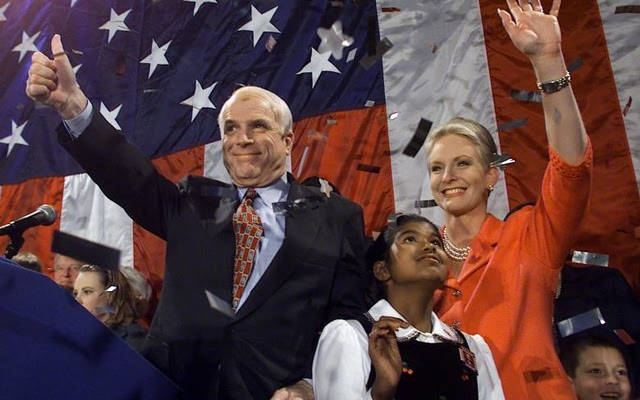 John McCain, his wife Cindy, and daughter Bridget celebrate with supporters on the evening of the Super Tuesday primaries in Los Angeles, March 2000. Reuters