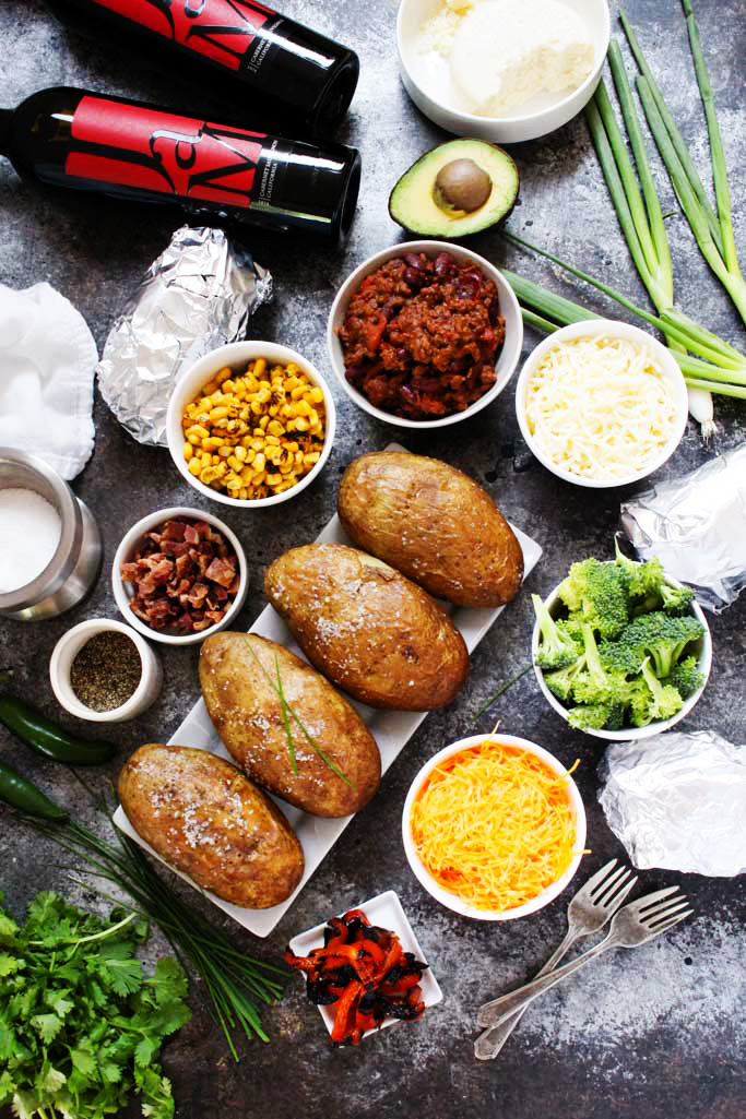 """Create a Grilled """"Baked"""" Potato Bar for your next party, potluck or tailgating event. It's a fun and festive way to feed a crowd, and the topping possibilities are endless. 