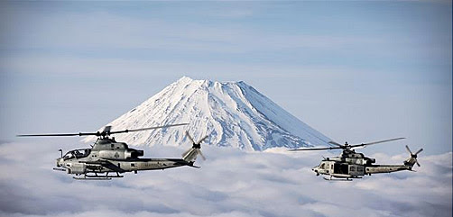 Two Marine Corps helicopters, an AH-1Z Viper and UH-1Y Venom, fly past Mount Fuji, Shizuoka, Japan, March 12, 2017 - ALLOW IMAGES