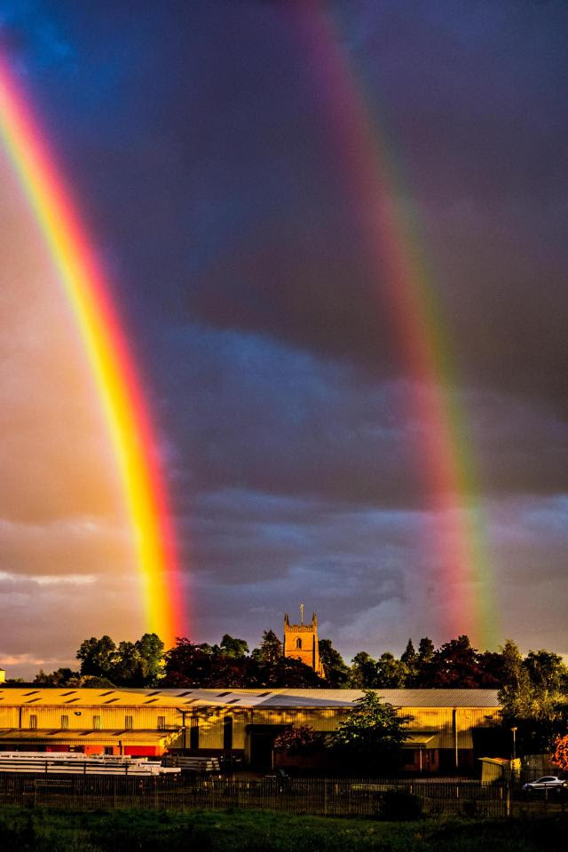 A double rainbow frames the Priory Church in Leominster, Herefordshire