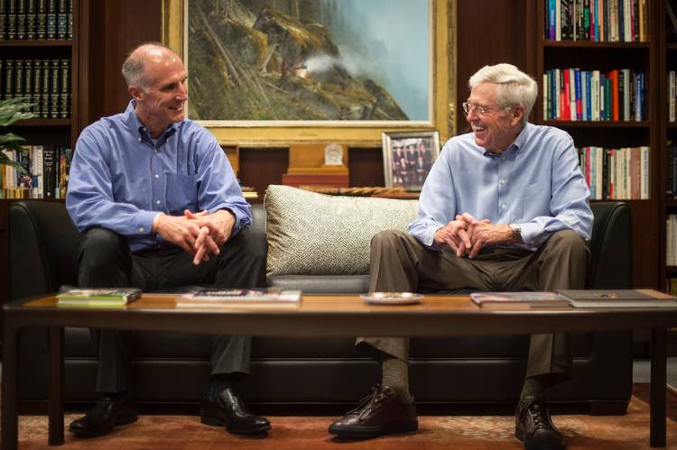 Mark Holden, general counsel for Koch Industries, chats with his boss, Charles Koch, in Wichita. (Nikki Kahn/The Washington Post)