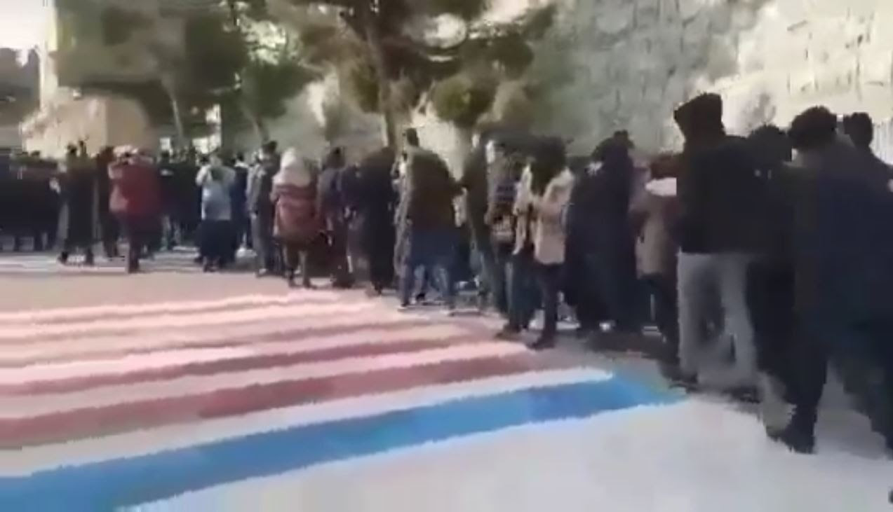 Students avoided walking on the flags painted by the regime at the entrance of the university