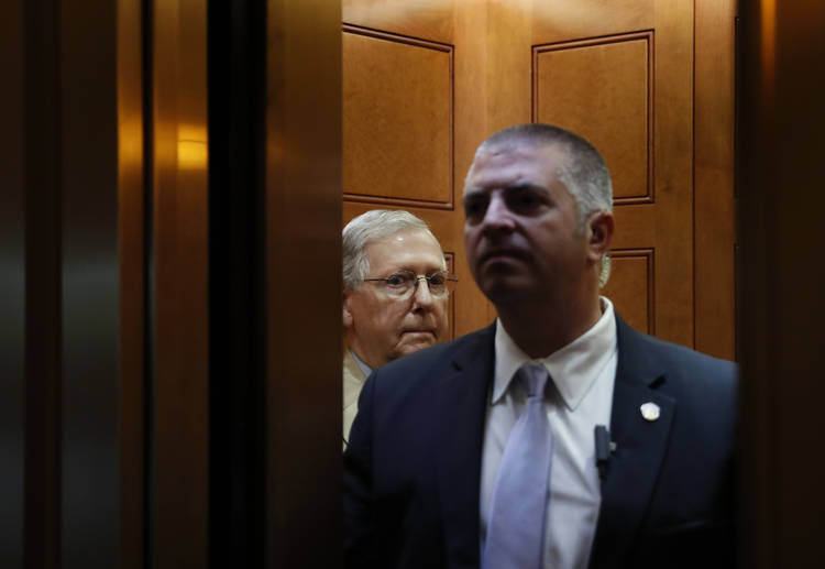 Senate Majority Leader Mitch McConnell (R-Ky.) boards an elevator in the Capitol. (Carolyn Kaster/AP)