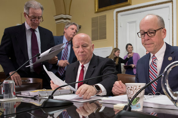 Representative Kevin Brady, seated left, chairman of the tax-writing Ways and Means Committee, and Representative Greg Walden, both Republicans.