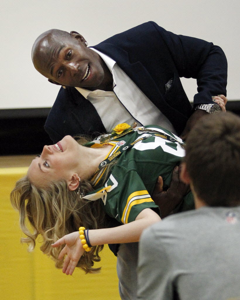 3605715 bytes; 2167 x 2703; donalddriver nws kwg 12--Donald Driver teaches teacher Elisabeth Schalk how to dance, during a visit