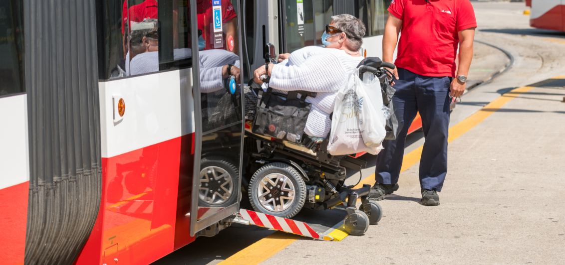 A TTC customer uses the streetcar ramp to enter the vehicle
