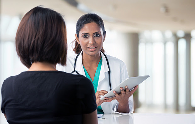 A doctor speaking with a female patient.