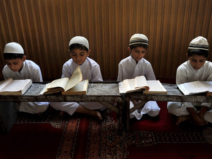 Children read and memorize the holy Quran, Islam's holy book, at a mosque in Jalalabad, Afghanistan.