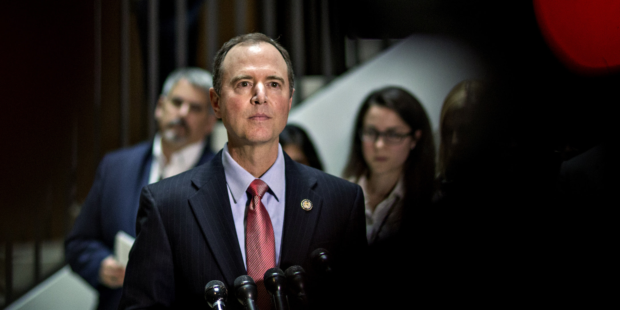 Adam Schiff in front of microphones