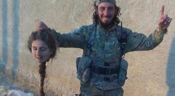 A Syrian Kurd                                                       woman, member of                                                       The People's                                                       Protection Units                                                       (Yekîneyên                                                       Parastina Gel –                                                       YPG) who was                                                       fighting for her                                                       family has been                                                       beheaded by                                                       takfiri terrorist                                                       of ISIS in Kobane.                                                       Shia Post                                                       According to                                                       reports, takfiri                                                       killer who shared                                                       his photo with                                                       head of a YPG's                                                       fighter has been                                                       sent to hell by                                                       YPG.