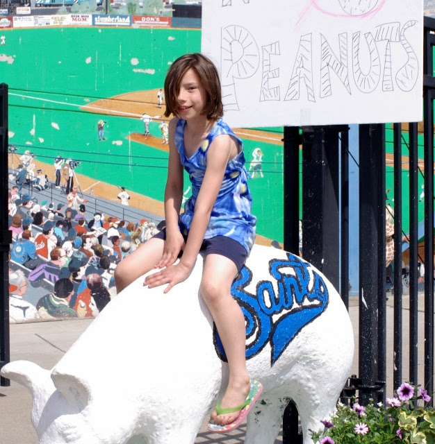Saints girl on pig 2012