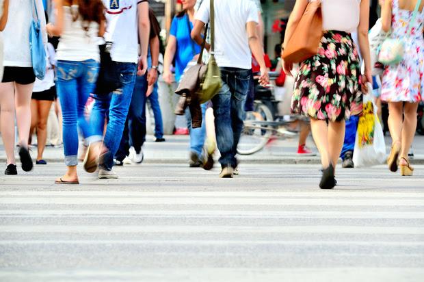People walking on a crowded street.