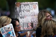 People protested on Tuesday in front of the White House against President Obama vetoing the bill that would allow 9/11 families to sue Saudi Arabia.