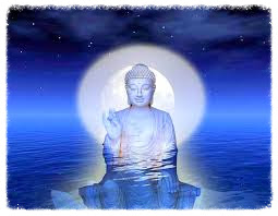Buddha at night with ocean
