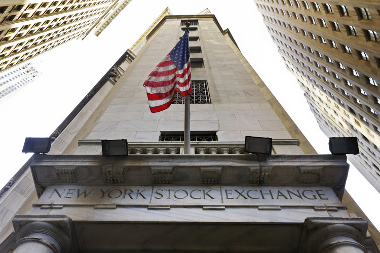 The American flag flies above the Wall Street entrance to the New York Stock Exchange. (Richard Drew/AP)