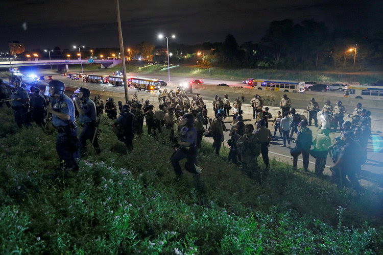 Protesters clash with law enforcement on Interstate 94 in Minnesota after a jury found a police officer not guilty of second-degree manslaughter in the death of Philando Castile. (Adam Bettcher/Reuters)</p>