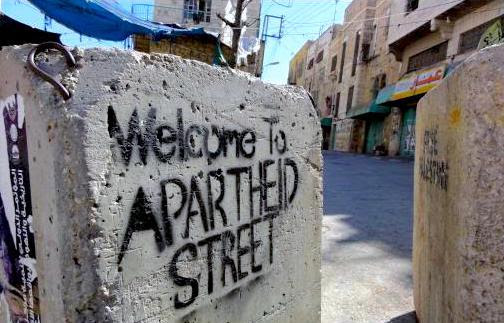 stencil graffiti says welcome to apartheid street