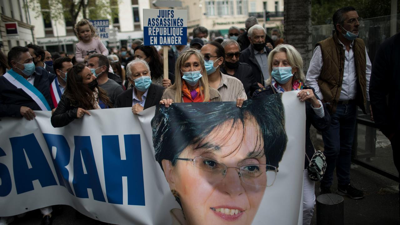 Protesters march with a banner of killed Jewish woman Sarah Halimi, during a demonstration in Marseille, in southern France, April 25, 2021.