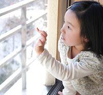 Child writing on a window