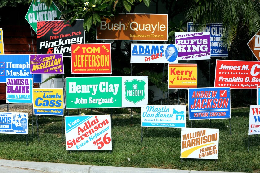 A lawn features election signs of all colors for failed candidates like John Kerry and Martin Van Buren