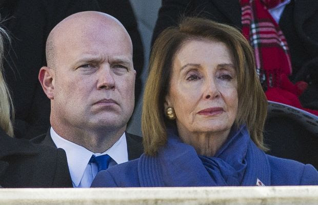 Acting United States Attorney General Matt Whitaker, left, and House Minority Leader Nancy Pelosi of Calif. attend the National Veterans Day Observance at Arlington National Cemetery in Arlington, Va., Sunday, Nov. 11, 2018. (AP Photo/Cliff Owen)
