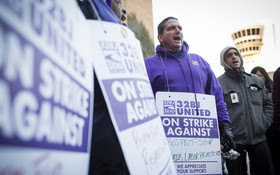 PHOTO: Some Philadelphia airport workers are protesting their employers' failure to meet the $12 per hour wage standard set by the city council. Photograph by Matt Stanley Photo.