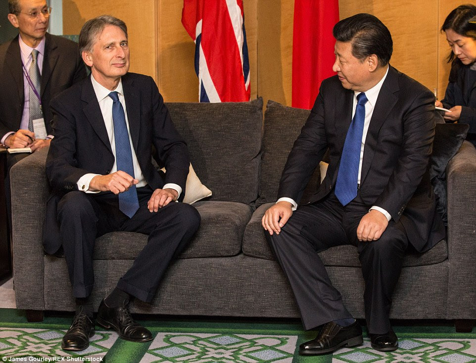 Mr Hammond and Mr Xi in a meeting after he touched down in London for his four-day state tour