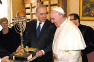 During a meeting at the Vatican on Monday, Prime Minister Netanyahu presented Pope Francis with a menorah and a copy of a book on the Spanish Inquisition by Netanyahu's father.