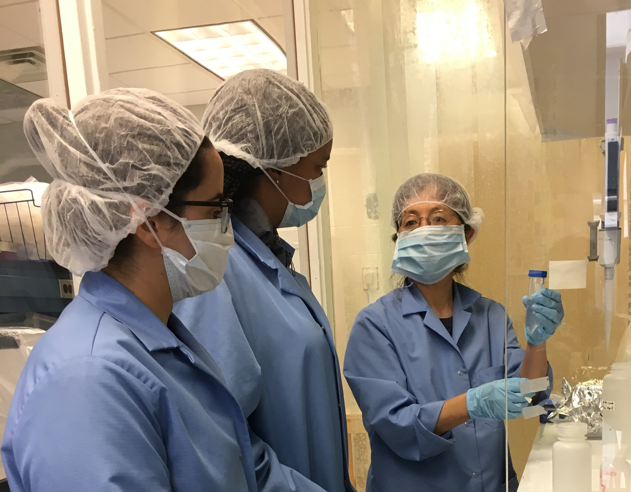 Dr. Gao shows undergraduate students procedures in the Gao Lab cleanroom