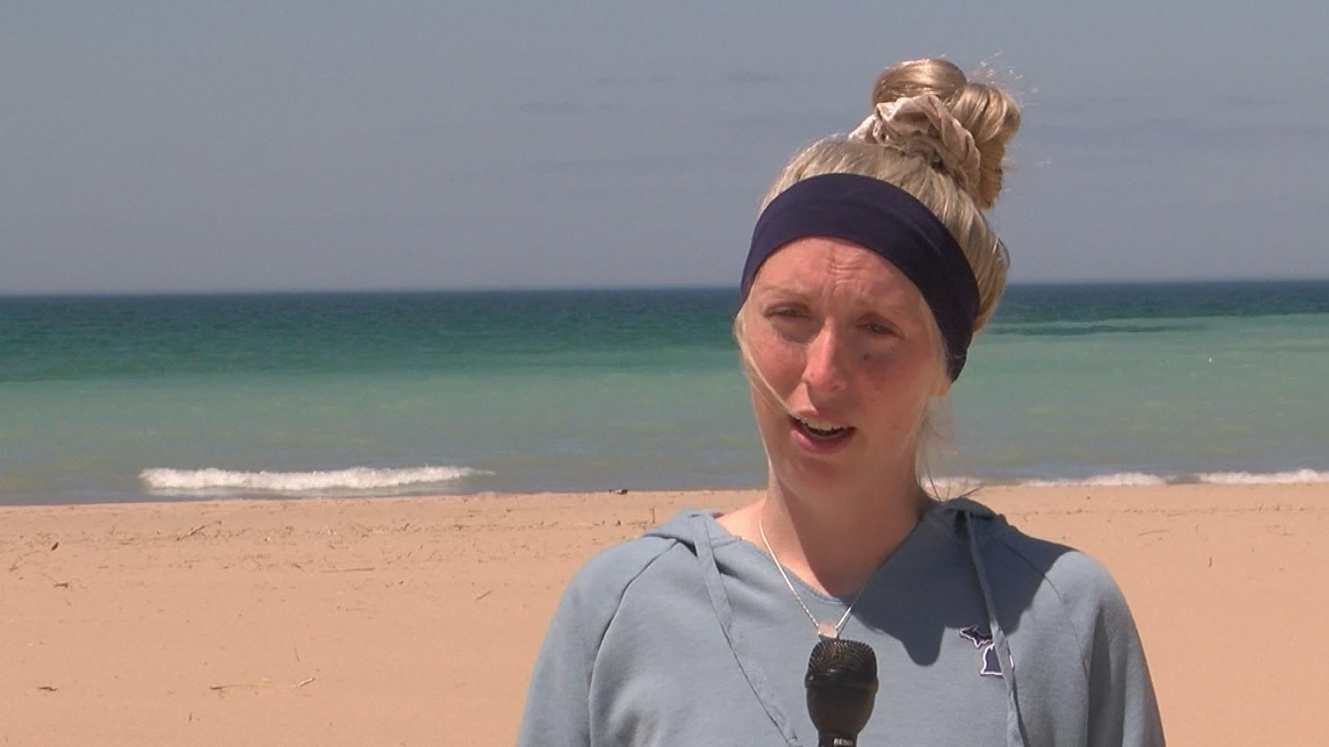 Woman giving an interview at a beach