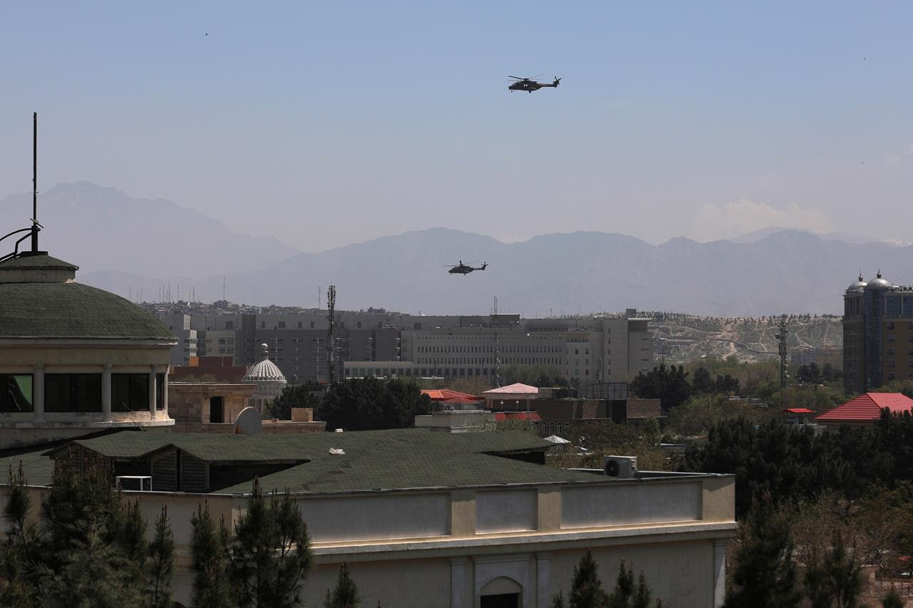 US Black Hawk military helicopters fly over the city of Kabul, Afghanistan, April 19, 2021.