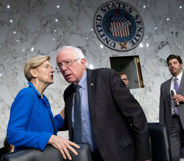 Elizabeth Warren and Bernie Sanders are among the senators who are pushing for a single-payer, government-run health care system. They conferred last week at a health committee meeting.