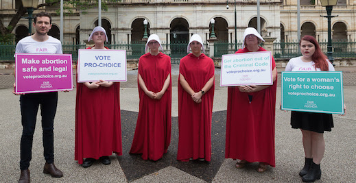 Handmaids with placards