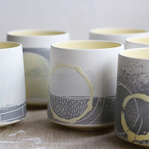 A photograph of ceramics vessels that focus on the painted details on the object.