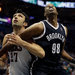 The Nets' Jason Collins (98) and the Bucks' Zaza Pachulia vying for a rebound. After the Nets' 4-2 trip, Collins is set for his first home game.