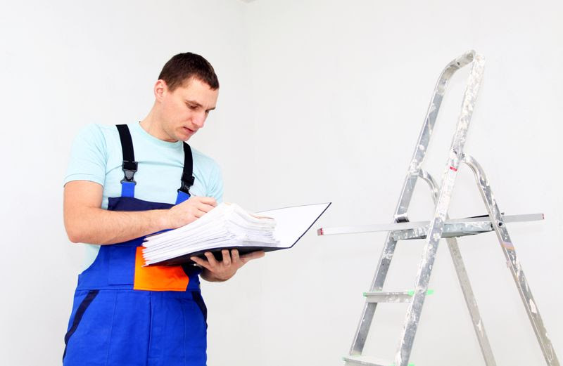 An employee inspects a ladder.