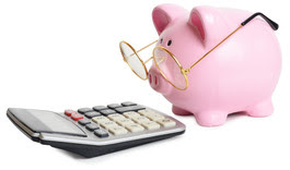 image of a calculator and a piggy bank