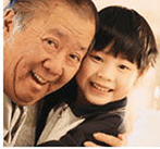 Asian gransdfather and grandson smiling