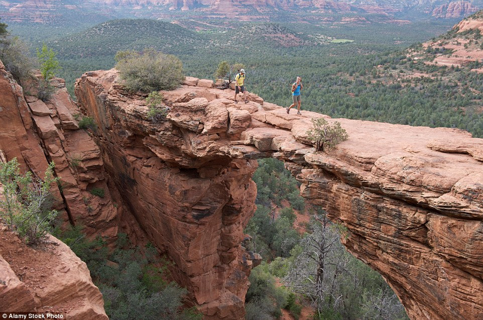 You                                                      won't want to                                                      stumble while                                                      walking across the                                                      Devil's Bridge in                                                      Red Rock-Secret                                                      Mountain                                                      Wilderness Area                                                      outside Sedona,                                                      Arizona, which has                                                      sheer drops either                                                      side of its arched                                                      structure