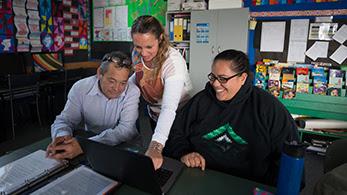 Facilitator with two teachers