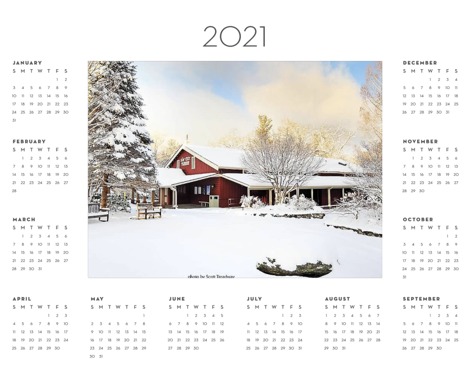 2021 year calendar with photo of the Flat Rock Playhouse Mainstage covered in snow.