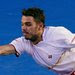 Stanislas Wawrinka of Switzerland hitting a return in his 6-3, 6-2, 3-6, 6-3 win over an ailing Rafael Nadal that gave him his first Grand Slam singles title, at 28.